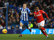 Brighton striker James Wilson & Charlton striker Ademola Lookman race for the ball during the Sky Bet Championship match between Brighton and Hove Albion and Charlton Athletic at the American Express Community Stadium, Brighton and Hove, England on 5 December 2015. Photo by Bennett Dean.