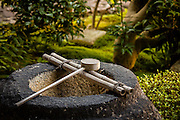A wooden ladle, used for purfication, rests at the entrance of a garden in one of the many temples at Tofukuji, Kyoto