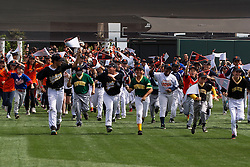 SAN FRANCISCO, CA - APRIL 07:  Members of the Junior Giants run on to the field before the game between the San Francisco Giants and the Los Angeles Dodgers at AT&T Park on April 7, 2016 in San Francisco, California. The San Francisco Giants defeated the Los Angeles Dodgers 12-6.  (Photo by Jason O. Watson/Getty Images) *** Local Caption ***