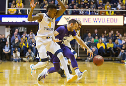 Jan 7, 2017; Morgantown, WV, USA; West Virginia Mountaineers guard Daxter Miles Jr. (4) and West Virginia Mountaineers guard Jevon Carter (2) force a turnover from TCU Horned Frogs guard Michael Williams (2) during the first half at WVU Coliseum. Mandatory Credit: Ben Queen-USA TODAY Sports