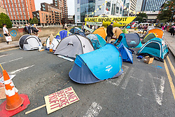 © Licensed to London News Pictures. 17/07/2019. Leeds, UK. The Extinction Rebellion protest has entered its third day in Leeds where activist's have blocked Victoria Bridge in the city centre with a boat & tents. The protest is part of Extinction Rebellion's 'summer uprising' campaign, which has seen similar blockades in London, Cardiff, Bristol and Glasgow & is expected to last until Friday. Photo credit: Andrew McCaren/LNP