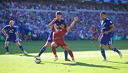 CARDIFF, WALES - Saturday, April 20, 2019: Liverpool's Mohamed Salah is brought down by Cardiff City's captain Sean Morrison for a penalty during the FA Premier League match between Cardiff City FC and Liverpool FC at the Cardiff City Stadium. (Pic by David Rawcliffe/Propaganda)