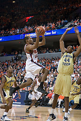 Virginia Cavaliers point guard Sean Singletary (44) leaps over Georgia Tech Yellow Jackets Forward/Center Alade Aminu (44) on this way to the basket.  The Virginia Cavaliers Men's Basketball Team defeated the Georgia Tech Yellow Jackets 75-69 at the John Paul Jones Arena in Charlottesville, VA on February 24, 2007.