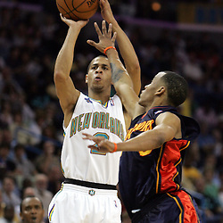 New Orleans Hornets guard Jannero Pargo #2 shoots over Golden State Warriors guard Monta Ellis #8 in the fourth quarter of their NBA game on April 6, 2008 at the New Orleans Arena in New Orleans, Louisiana.