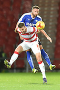 Andy Williams of Doncaster Rovers and Ian Evatt of Chesterfield FC  during the Sky Bet League 1 match between Doncaster Rovers and Chesterfield at the Keepmoat Stadium, Doncaster, England on 24 November 2015. Photo by Ian Lyall.