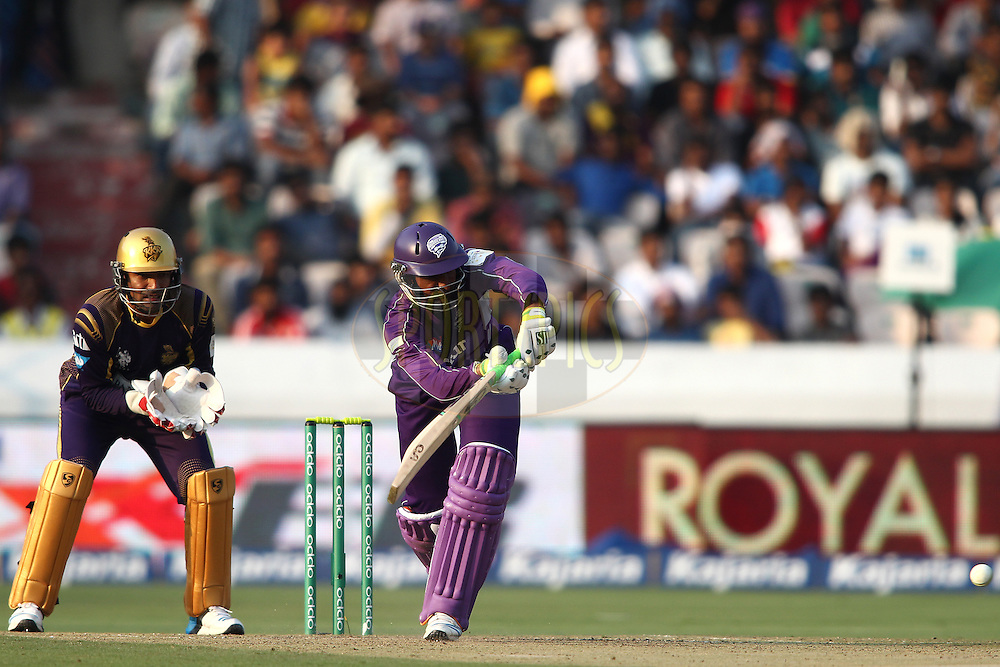 Shoaib Malik of the Hobart Hurricanes plays a delivery through the leg side during the first semi final match of the Oppo Champions League Twenty20 between the Kolkata Knight Riders and the Hobart Hurricanes held at the Rajiv Gandhi Cricket Stadium, Hyderabad, India on the 2nd October 2014<br /> <br /> Photo by:  Shaun Roy / Sportzpics/ CLT20<br /> <br /> <br /> Image use is subject to the terms and conditions as laid out by the BCCI/ CLT20.  The terms and conditions can be downloaded here:<br /> <br /> http://sportzpics.photoshelter.com/gallery/CLT20-Image-Terms-and-Conditions-2014/G0000IfNJn535VPU/C0000QhhKadWcjYs