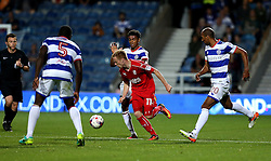 James Brophy of Swindon Town runs with the ball against three Queens Park Rangers defenders - Mandatory by-line: Robbie Stephenson/JMP - 10/08/2016 - FOOTBALL - Loftus Road - London, England - Queens Park Rangers v Swindon Town - EFL League Cup