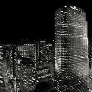 Originally known as the RCA Buidling designed by architect Raymond Hood, 30 Rockefeller Plaza is seen at night in a classic black and white image.