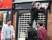 16.MARCH.2013. ESSEX<br /> <br /> TOWIE STAR JOEY ESSEX SEEN GETTING THE KEYS TO HIS NEW SHOP CALLED FUSEY AND GETTING THE SIGN TO HIS NEW SHOP PUT UP IN BRENTWOOD ESSEX. THE SIGN MAN WAS UNLUCKY AND ENDED UP GETTING A PARKING TICKET OUTSIDE JOEYS SHOP<br /> <br /> BYLINE: EDBIMAGEARCHIVE.CO.UK/ MAGICMOMENTSUK <br /> <br /> *THIS IMAGE IS STRICTLY FOR UK NEWSPAPERS AND MAGAZINES ONLY*<br /> *FOR WORLD WIDE SALES AND WEB USE PLEASE CONTACT EDBIMAGEARCHIVE - 0208 954 5968*
