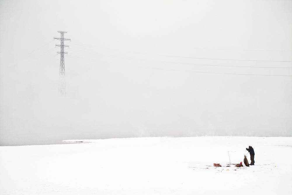 A lone man ice fishing on the Angara River, Irkutsk.