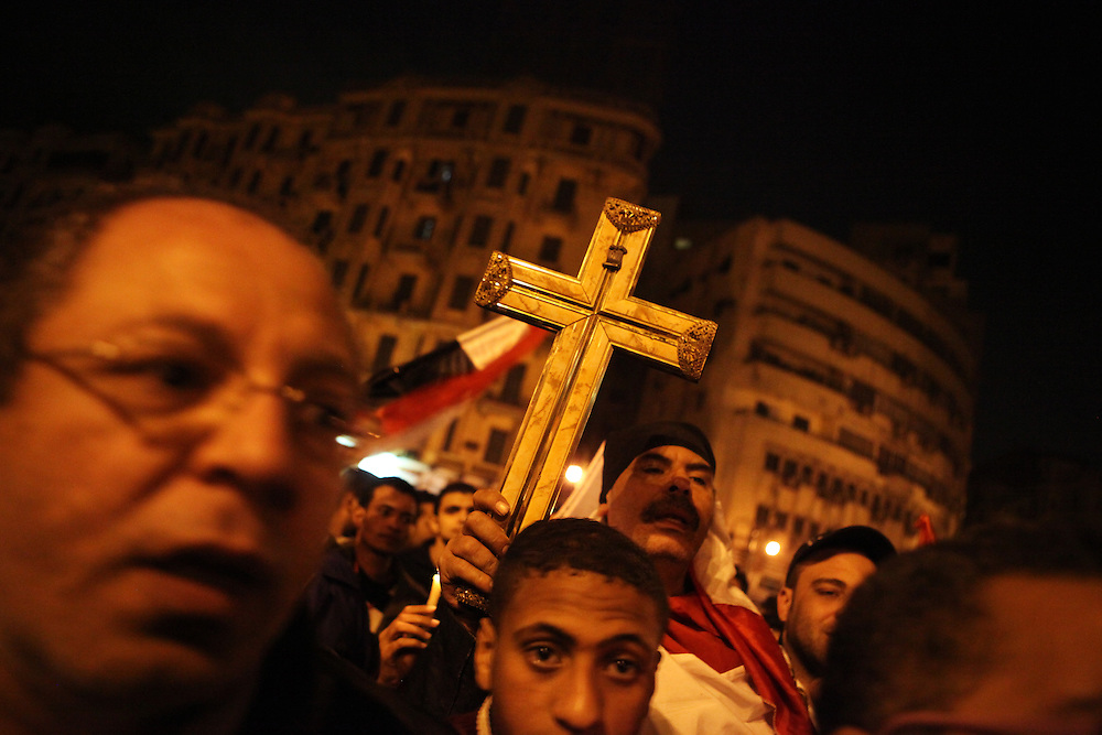Coptic Christians and Muslims calling for unity between Muslims and Christians protest at Tahrir Square, 9 February.