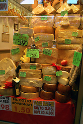 Padua (Padova): This tower of cheese is typical of what's available at the market stalls on the ground floor of Palazzo della Ragione (Il Salone).  The building itself was erected in 1218 and rebuilt in 1306.