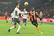 Hull City player Oumar Niasse (24) and Manchester United player Chris Smalling (12) during the EFL Cup semi final match 2 between Hull City and Manchester United at the KCOM Stadium, Kingston upon Hull, England on 26 January 2017. Photo by Ian Lyall.