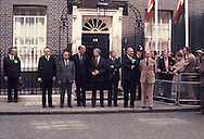 The G 7 Economic Summit in London May 7, 1977.  The Heads of state standing in front of  Number 10 Downing Street.  Her's how it came about.  The host Prime minister Callahan was running for election and needed all of the help he could get.  The Summit was  to be his big boost.  In between greeting the heads of states as they rolled up to Number 10, he would stroll over to talk to the photographers.  There was no group photo planned for that first day, but we,the photographers, really wanted one.  Bob Daughtery, AP. Paul Slade PARIS MATCH and I working for TIME said that a group picture in front of number 10 would be on the front of every newspaper in the world the next morning.  Prime Minister Callahan said,&quot;I'll raise it with chaps.&quot;  First the heads of security details came out glaring at us, then the heads of state, but they had the secretaries and staff behind them.  We yelled, &quot;get the underlings out of the background&quot; and they compilied.  Then we yelled &quot;close the door&quot;  we had to see number 10 on the door. And that is how this picture was made.  <br /> Photo by Dennis Brack