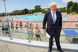 © Licensed to London News Pictures. 10/07/2015. London, UK. Boris Johnson visiting Hillingdon Sports and Leisure Complex in Uxbridge, London to take part in a street cricket tournament on Friday, July 10, 2015. The Mayor of London playing the game to support grassroots sports for community cohesion as the Ashes gets under way. Photo credit: Tolga Akmen/LNP