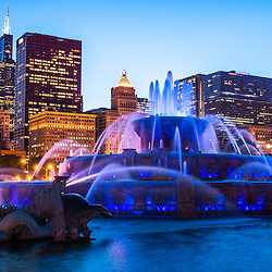 High resolution photo of Chicago skyline at night with Buckingham Fountain and Willis Tower skyscraper (Sears Tower). The Clarence F. Buckingham Memorial Fountain is a Chicago landmark and very popular attraction located in Grant Park in the downtown Chicago Loop.