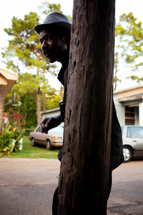 Frank Stringfellow drunkenly leans against a pole in the Baptist Town neighborhood of Greenwood, Mississippi on Friday, July 2, 2010 after an afternoon of heavy drinking.