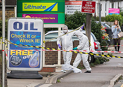 © Licensed to London News Pictures. 05/08/2017. Chelsford, UK. Police and forensics at the scene where man has died after being shot in the chest in the early hours of Saturday August 5, to Baddow Road, Chelmsford. The victim and another man, both aged in their 20s, were outside the BP garage near the Army and Navy roundabout when a blue Ford Fiesta pulled up.  He was shot by an occupant of the car, which drove off. He was taken to hospital, where he sadly died.Photo credit : Simon Ford/LNP