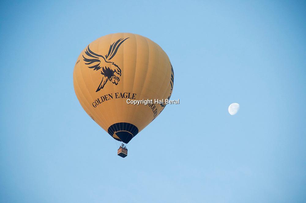 Hot air ballon with partial moon<br /> Bagan,Myanmar