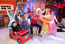 **Embargoed untill 6am Friday 28th November**  Repro Free: 27/11/2014 Ryan Tubridy is pictured revealing the set for this years The Late Late Toy Show - and it promises to be Truly Scrumptious! The theme of this year's show is based on the iconic musical film Chitty Chitty Bang Bang with the opening act to include a performance of a much-loved song from the film with Ryan taking part in the performance. Ryan is pictured with just 7 of the 269 performers and toy testers in this years show Hannagh Doyle (8) from Carlow, Max O'Brien Kane (5) from Carlow, Noah Oglesby (7) from Carlow, Dylan O'Connor (7) from Dublin, Cara Hayes (9) from Dublin, Julia Dempsey (8) from Carlow and Erin Murphy (9) from Carlow. Picture Andres Poveda
