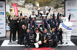 Sebastien Ogier and his co pilot Julien Ingrassia with their M-Sport Ford Team celebrate their victory during day four of the DayInsure Wales Rally GB.