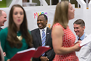 Former Neurosurgeon and Republican presidential candidate Dr. Ben Carson enjoys Christmas carols during a visit to the MUSC Children's Hospital December 22, 2015 in Charleston, South Carolina. Carson stopped by to listen to Christmas carols and greet the young patients.