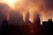 The sun rises through the smoke in New York City September 12, 2001 the morning after the terrorist attack.