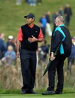 Photo: Daniel Hambury.<br /> WGC American Express Championship, The Grove. 01/10/2006.<br /> Tiger Woods shows his concern as the weather goes from bad to worse.