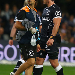 DURBAN, SOUTH AFRICA - JUNE 13: DR Alan Kourie with Marcell Coetzee of the Cell C Sharks during the Super Rugby match between Cell C Sharks and DHL Stormers at Growthpoint Kings Park on June 13, 2015 in Durban, South Africa. (Photo by Steve Haag/Gallo Images)