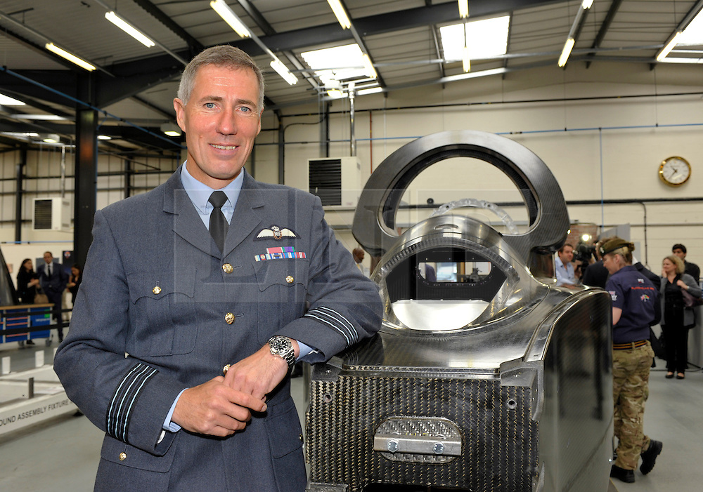 © Licensed to London News Pictures. 04/07/2013. Bristol, UK.  Wing Commander Andy Green, who will pilot the Bloodhound Supersonic Car, at the project's official opening of the new technical centre in Avonmouth, Bristol.  The car is being built to go at 1000mph to break the land speed record, powered by a rocket and a Rolls Royce EJ200 jet engine with a Cosworth engine being used as a pump.  The record attempt will take place in South Africa.  David Willetts, Minister for Science and Universities took part in joining parts of the bodywork together.  04 July 2013.<br /> Photo credit : Simon Chapman/LNP