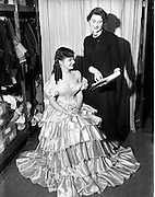 21/11/1952<br /> 11/21/1952<br /> 21 November 1952<br /> Miss Maureen Bourke and Miss Palken at P.J. Bourke costumiers Dame Street, Dublin. Dresses for Victorian themed Ball by Miss Bourke.