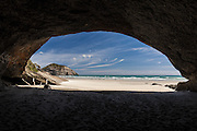 Wharariki Beach, from within a large cave.