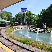 The Detroit Zoo is located about 2 miles (3.2 km) north of the Detroit city limits at the intersection of Woodward Avenue, 10 Mile Road, and 696 in Royal Oak and Huntington Woods, Michigan, USA. The Detroit Zoological Society, a non-profit organization, operates both the Detroit Zoo and the Belle Isle Nature Zoo, located in the city of Detroit. The Detroit Zoological Society is responsible for the care and feeding of more than 1,800 vertebrates and 5,000 invertebrates representing over 270 species.