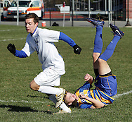 Lansing's Cobi Byrne, right, falls to the ground after battling a Tyler Rondeau of Hoosick Falls for the ball during a Class C state semifinal boys' soccer game at Faller Field in Middletown on Saturday, Nov. 17, 2012.