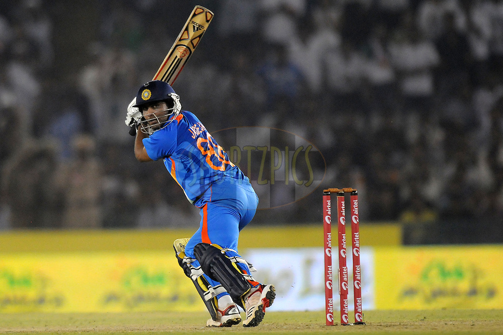 Ravindra Jadeja bats during the 3rd One Day International ( ODI ) match between India and England held at  the PCA Stadium, Mohali on the 20th October 2011..Photo by Pal Pillai/BCCI/SPORTZPICS.