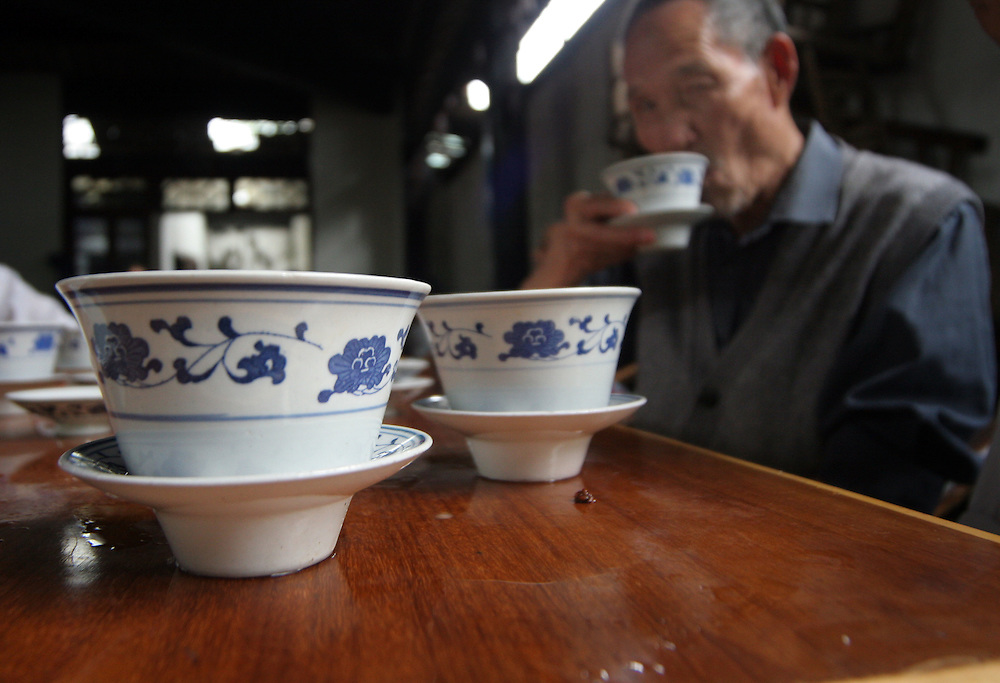 A Chinese pensioner sips a cups of green tea at a typical Chengdu teahouse.