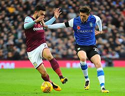 Robert Snodgrass of Aston Villa jostles with George Boyd of Sheffield Wednesday  - Mandatory by-line: Nizaam/Jones - 04/11/2017 - FOOTBALL - Villa Park - Birmingham, England - Aston Villa v Sheffield Wednesday - Sky Bet Championship
