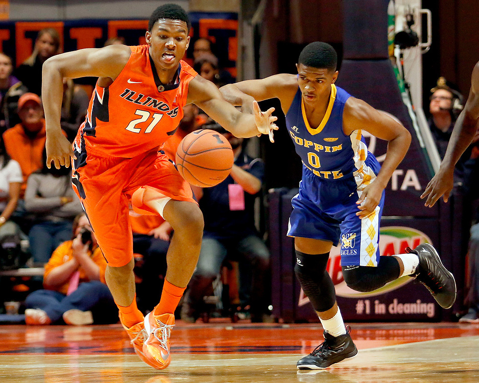 Illinois guard Malcolm Hill (21) chases a ball against Coppin State guard Van Rolle (0) during the first half of an NCAA college basketball game at the State Farm Center Sunday, Nov. 16, 2014, on the University of Illinois campus in Champaign, Ill. (Lee News Service/ Stephen Haas)