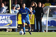 AFC Wimbledon striker Kweshi Appiah (9) dribbling with AFC Wimbledon manager Neal Ardley looking on during the EFL Sky Bet League 1 match between AFC Wimbledon and Oxford United at the Cherry Red Records Stadium, Kingston, England on 29 September 2018.