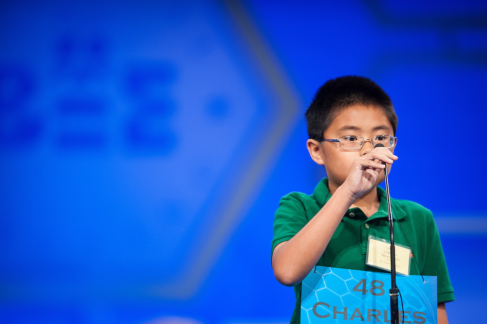 Charles Sirui Li, 11, of Martinez, Georgia, participates in round two of the preliminaries of the Scripps National Spelling Bee on May 28, 2014 at the Gaylord National Resort and Convention Center in National Harbor, Maryland.