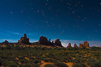 The wonderous rock formations of Utah's Arches National Park look even more spectacular on a wildly moonlit night in the Moab Desert.