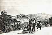western men traveling by car in the mountains of Morocco 1930s