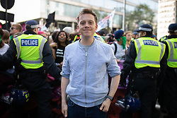 © Licensed to London News Pictures. 13/10/2018. London, UK. Journalist Owen Jones joins counter demonstrators from Stand Up To Racism and Unite Against Fascism demonstrate against the Democratic Football Lads Alliance (DFLA). The DFLA are holding a demonstration in central London. Strict conditions have been imposed upon the march to prevent 'serious disorder' following previous demonstrations. Photo credit : Tom Nicholson/LNP