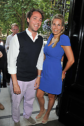 DAN PHILLIPSON and VERITY EVETTS at the launch of Hideaways House at Morton's Club, Berkeley Square, London on 25th July 2012.