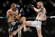 "DUBLIN, IRELAND, JULY 19, 2014: Action in and around the cage during ""UFC Fight Night: McGregor vs. Brandao"" inside the O2 in Dublin, Ireland on Saturday, July 19 (© Martin McNeil)"