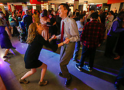 Jake Schoenborn and Megan Grable dance together during Camp Barnabas' Snow Ball at Glendale High School on Saturday, Jan. 20, 2018.