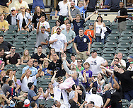 CHICAGO - JUNE 04:  Fans reach for a home run ball hit by Brendan Boesch #26 of the Detroit Tigers during the game against the Chicago White Sox on June 4, 2011 at U.S. Cellular Field in Chicago, Illinois.  The Tigers defeated the White Sox 4-2.  (Photo by Ron Vesely)  Subject:   Brendan Boesch