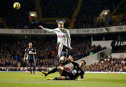 Christian Eriksen of Tottenham Hotspur is challenged by Muhamed Besic of Everton - Photo mandatory by-line: Rogan Thomson/JMP - 07966 386802 - 30/11/2014 - SPORT - FOOTBALL - London, England - White Hart Lane - Tottenham Hotspur v Everton - Barclays Premier League.