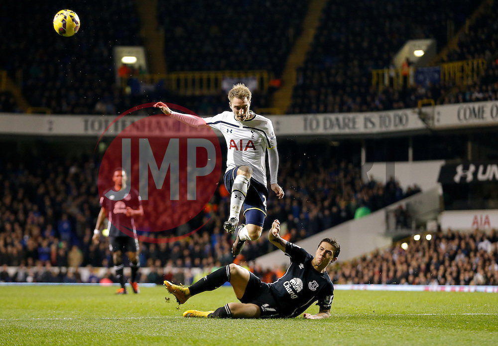 Christian Eriksen of Tottenham Hotspur is challenged by Muhamed Besic of Everton - Photo mandatory by-line: Rogan Thomson/JMP - 07966 386802 - 30/11/2014 - SPORT - FOOTBALL - London, England - White Hart Lane - Tottenham Hotspur v Everton - Barclays Premier League.
