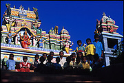 Children in front of a colourful Hindu Kovil apparent (!) close to Adams Peak. I can' t wuite remember where.